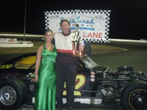 Bobby Wheeler and the Trophy Girl.  Bobby handed off his trophy a little girl who had never attended a race before.  A big night for everyone.