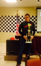 Kyten holding his trophy for Most Improved Driver, voted in by his peers.