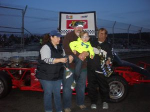 Vern Huson and our Club Sponsor, Big Mountain Mail. Pictured with Vern is Erika, John and 6-year old Logan